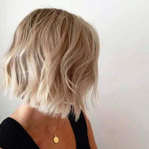 Short Ruffled Haircut with Blonde Colored Highlights
