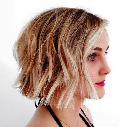Blonde Wavy Haircut with Choppy Tips