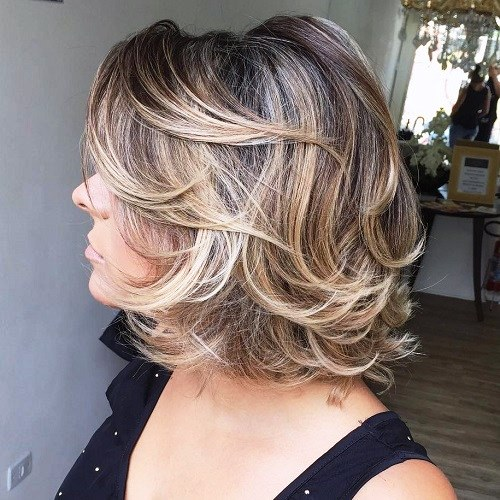 Over 50 Mid-Length Curly Haircut with Bangs