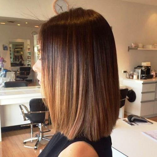 Dark Collarbone Haircut with Highlights