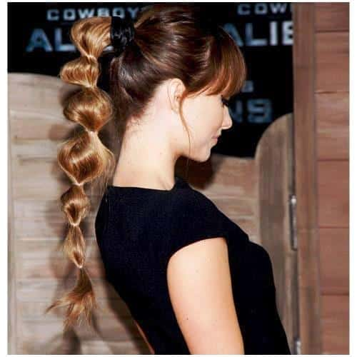 Long layered Ponytails with Stylish Head Puff