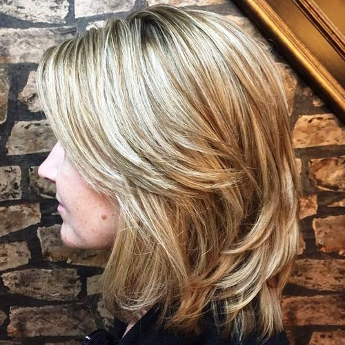 Platinum Haircut with Feathered Layers on the Top