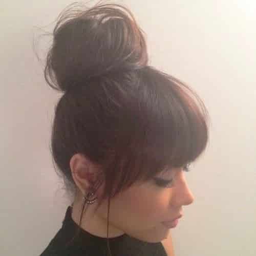 Face-Framing Bangs with a Low Puff