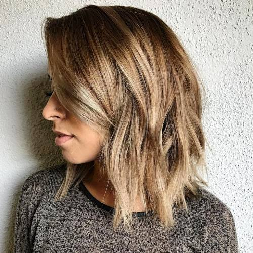 Trendy Mid Length Haircut With Side Fringe