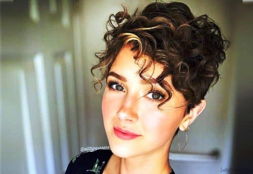 Curly pixie hair cut with bangs