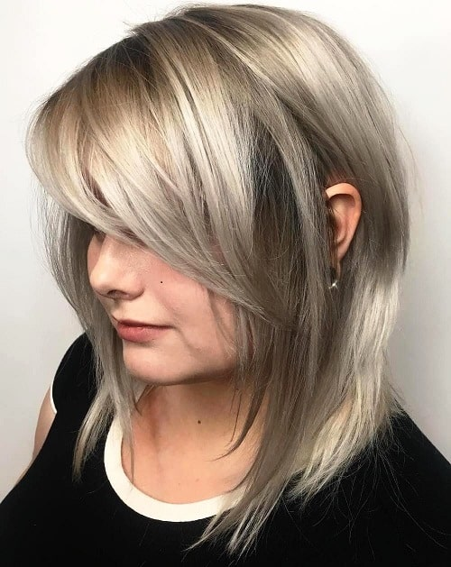 Blunt Bob with Side-Swept Bangs –Medium Length Hairstyles Over 40